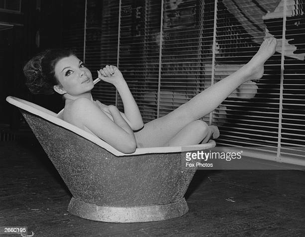 Actress Vivienne Taylor who appeared at the 'Pigalle' Piccadilly in a revue entitled 'We're No Angels' sitting in a bath during rehearsals