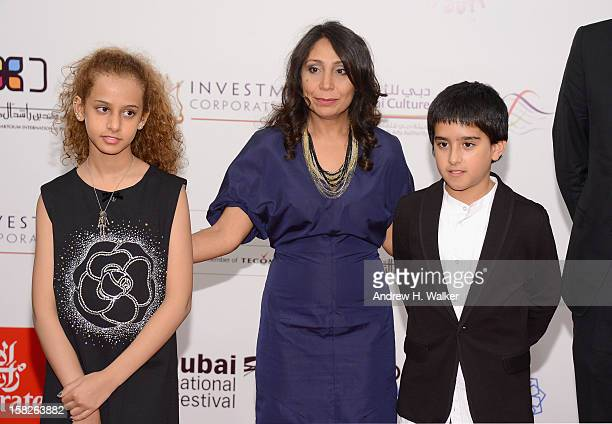 Actress Waad Mohammed director Haifaa Al Mansour and actor Abdulrahman al Guhani attend the 'Wadjda' premiere during day four of the 9th Annual Dubai...