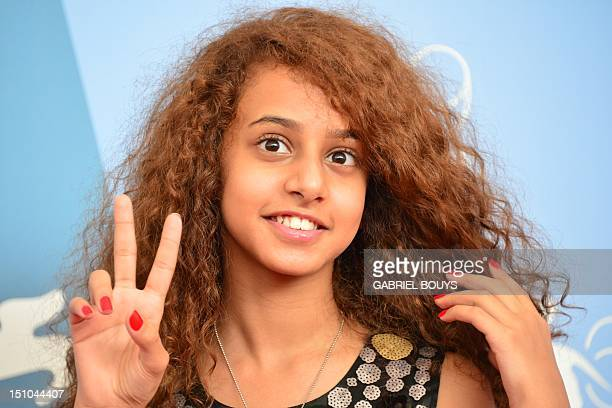 Actress Waad Mohammed poses during the photocall of Wadjda at the 69th Venice Film Festival on August 31 2012 at Venice Lido Wadjda is competing in...