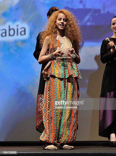 Actress Waad Mohammed with the Muhr Arab Feature Best Actress award on stage during the Closing Ceremony on day eight of the 9th Annual Dubai...