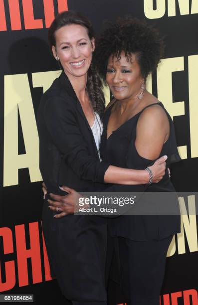 Actress Wanda Sykes and wife Alex Sykes arrive for the Premiere Of 20th Century Fox's Snatched held at Regency Village Theatre on May 10 2017 in...