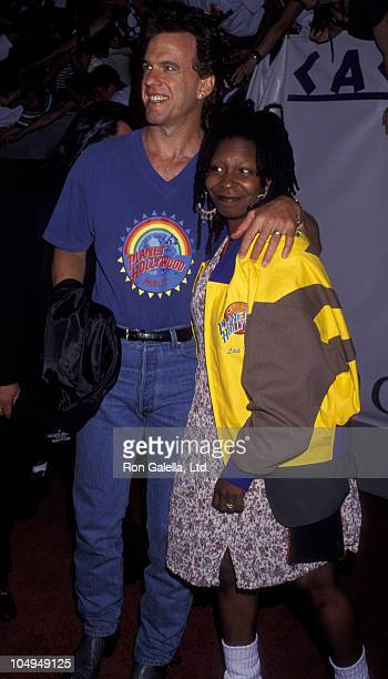 Actress Whoopi Goldberg and Lyle Trachtenberg attend the grand opening of Planet Hollywood on July 24 1994 in Las Vegas Nevada
