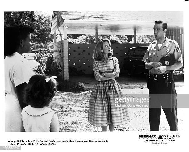 Actress Whoopi Goldberg Lexi Randall Sissy Spacek and actor Hanes Brooke on set of the movie The Long Walk Home circa 1990