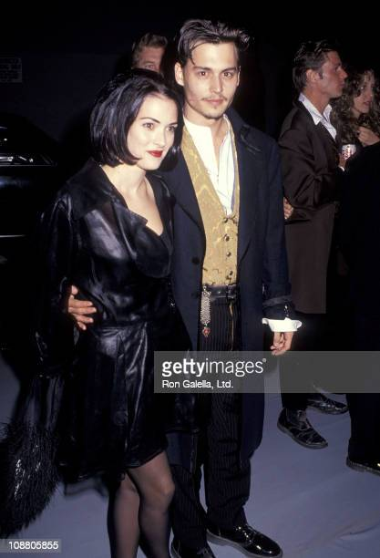 Actress Winona Ryder and actor Johnny Depp attend the Edward Scissorhands Westwood Premiere on December 6 1990 at Avco Center Cinemas in Westwood...