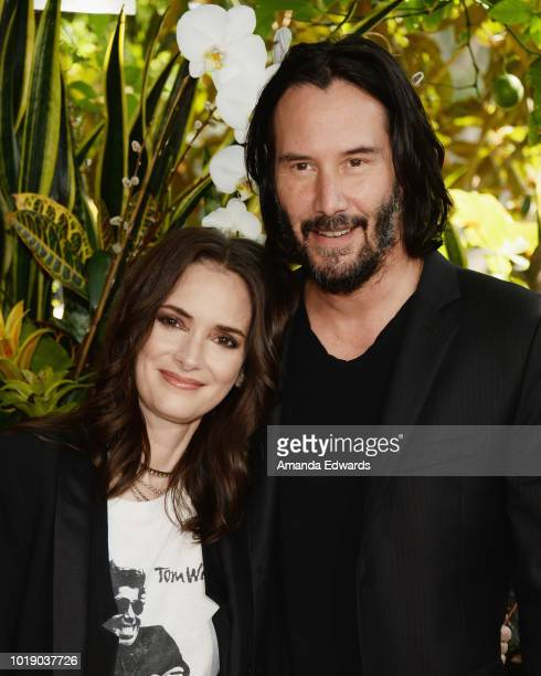 Actress Winona Ryder and actor Keanu Reeves attend a photo call for Regatta's Destination Wedding at the Four Seasons Hotel Los Angeles at Beverly...