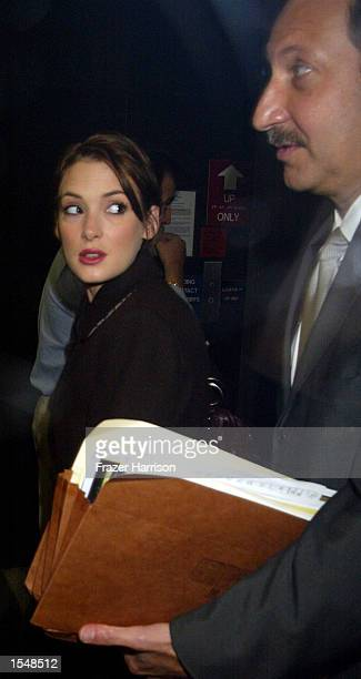 Actress Winona Ryder and her lawyer Mark Geragos arrive at the Beverly Hills Municipal Court for the secon day of her shoplifting trial on October 29...