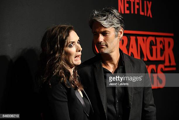 Actress Winona Ryder and Scott Mackinlay Hahn attend the premiere of 'Stranger Things' at Mack Sennett Studios on July 11 2016 in Los Angeles...