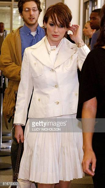 Actress Winona Ryder arrives at Beverly Hills courthouse in Beverly Hills CA 04 November 2002 Ryder is on trial on charges of theft commercial...