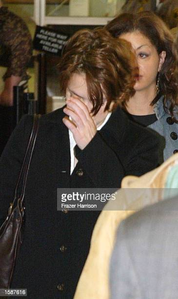 Actress Winona Ryder enters the Beverly Hills Municipal Court for jury deliberations on the seventh day of her shoplifting trial on November 5, 2002...