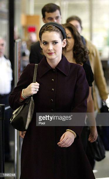Actress Winona Ryder enters the Beverly Hills Municipal Court for the reading of the verdict on the eighth day of her shoplifting trial on November 6...
