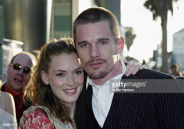 """Actress Winona Ryder greets Actor Ethan Hawke at the Los Angeles Film Festival Premiere of """"Before Sunset"""" at the Archlight Cinema on June 23, 2004..."""