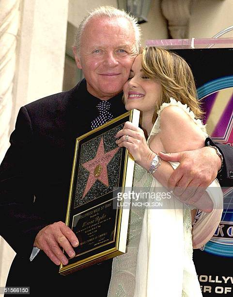 US actress Winona Ryder is hugged by British actor Anthony Hopkins after a star was unveiled for her on the Hollywood Walk of Fame in Hollywood CA 06...
