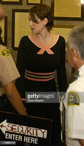 Actress Winona Ryder is seen through a tinted glass as she arrives at the Beverly Hills Superior Court for her trial on charges of alleged grand...