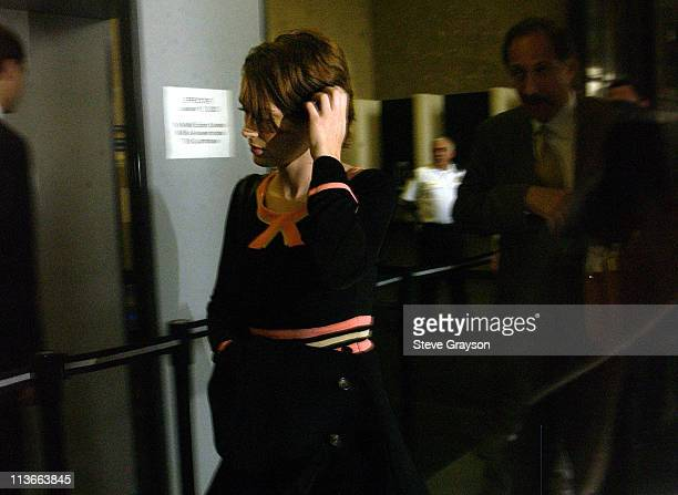 Actress Winona Ryder is seen through a tinted glass as she arrives at the Beverly Hills Municipal Court House in her trial on charges of alleged...