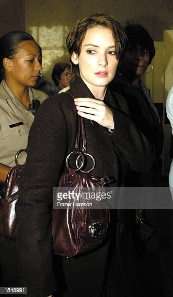 Actress Winona Ryder is seen through tinted glass as she exits the Beverly Hills Municipal Court on the second day of her shoplifting trial on...