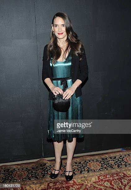 Actress Winona Ryder poses backstage at the Marc Jacobs Spring 2014 fashion show at The New York State Armory 68 Lexington on September 12 2013 in...