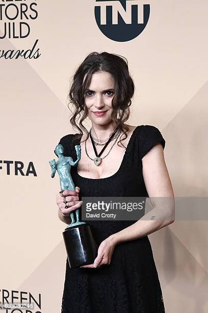Actress Winona Ryder recipient of the Outstanding Ensemble in a Drama Series award for 'Stranger Things' poses in the press room at the 23rd Annual...