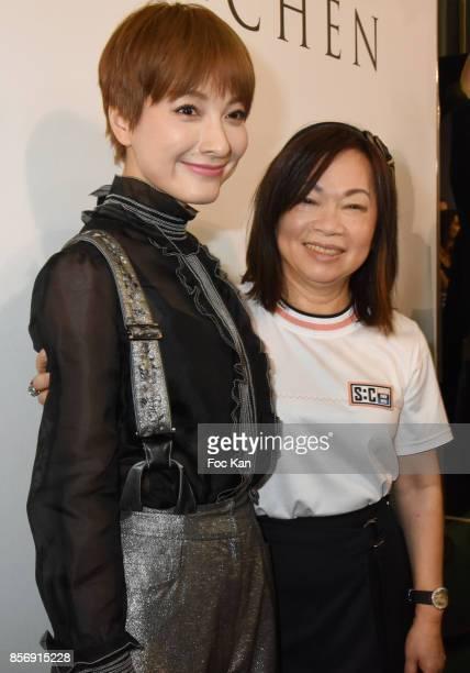 Actress Wu Xin and designer Wang Chen TsaiHsia from Schiatzy Chen attend the Schiatzy Chen show as part of the Paris Fashion Week Womenswear...
