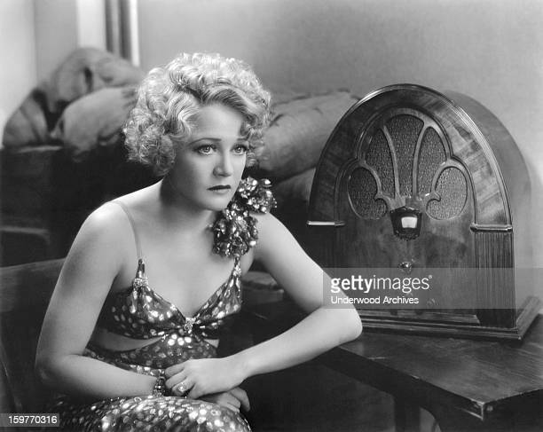 Actress Wynne Gibson listening to apparently bad news on the radio in the film 'Lady And Gent' Hollywood California 1932