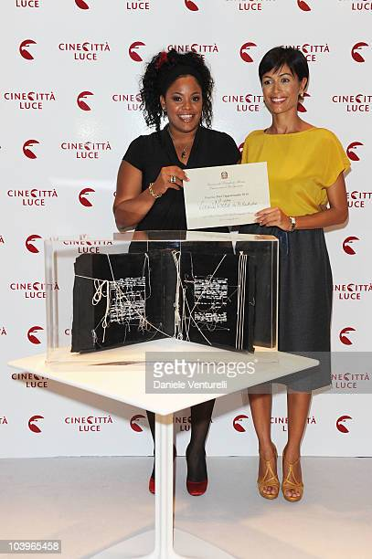 Actress Yahima Torres receives an award for the film 'Venus Noire' from Mara Carfagna during the Equal Opportunity Award Ceremony at the Hotel...