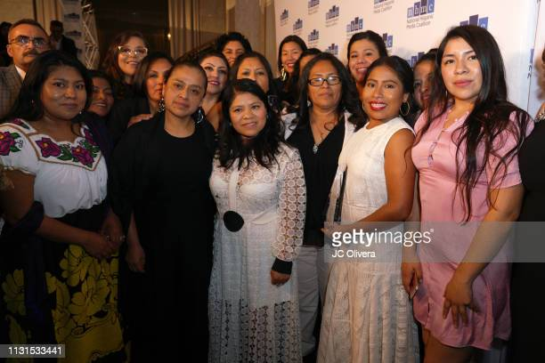 Actress Yalitza Aparicio poses with members of the National Domestic Workers Alliance during the 22nd Annual National Hispanic Media Coalition Impact...