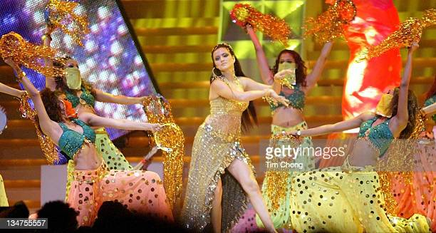 Actress Yana Gupta gyrates to a selection of dances in a tribute to veteran actress Helen at the IIFA Awards in Singapore May 22 2004