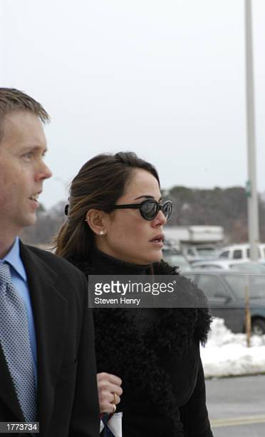 Actress Yancy Butler and an unidentified companion arrive at the Suffolk County Court Complex February 10 2003 in Central Islip New York Butler faces...