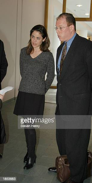Actress Yancy Butler and her lawyer Michael J Brown leave the Suffolk County Court House March 17 2003 in Central Islip New York Butler was appearing...