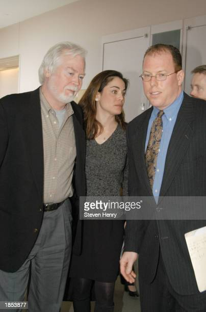 Actress Yancy Butler her father Joe Butler and her lawyer Michael J Brown leave the Suffolk County Court House March 17 2003 in Central Islip New...