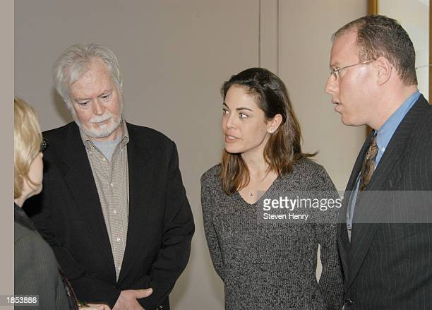 Actress Yancy Butler her father Joe Butler and her laywer Michael J Brown leave the Suffolk County Court House March 17 2003 in Central Islip New...