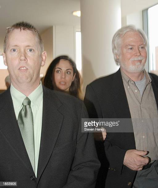 Actress Yancy Butler her father Joe Butler and her laywer Michael J Brown arrive at the Suffolk County Court House March 17 2003 in Central Islip New...