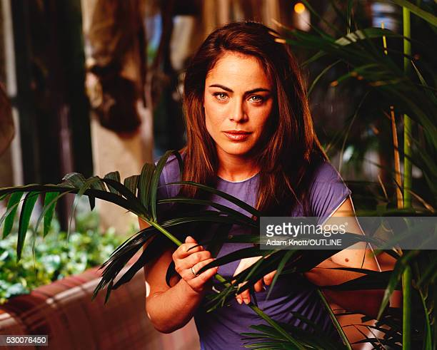 actress yancy butler in purple t-shirt with fronds - yancy butler stock pictures, royalty-free photos & images