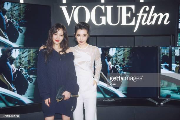 Actress Yang Mi and actress Li Bingbing pose on the red carpet of 2018 Vogue Film Gala on June 15 2018 in Shanghai China