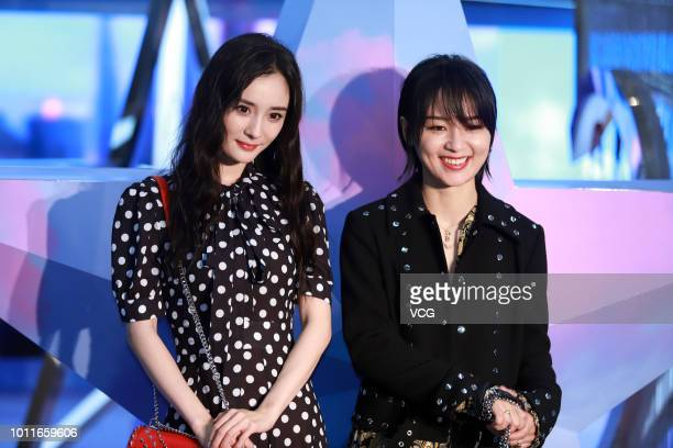 Actress Yang Mi and singer Bibi Zhou attend the opening ceremony of Michael Kors Whitney popup store on August 1 2018 in Shanghai China
