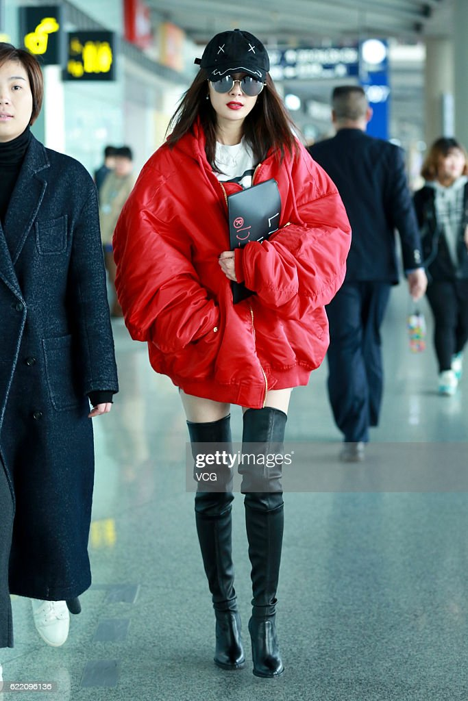 Actress Yang Mi arrives at the Beijing Capital International Airport on November 9, 2016 in Beijing, China.