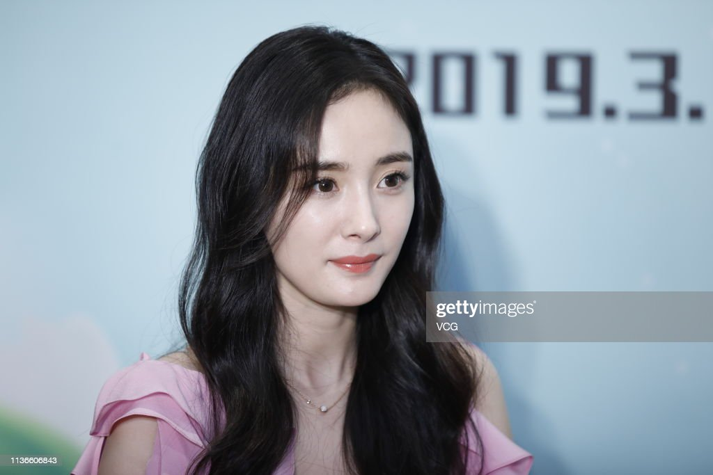 CHN: Yang Mi Attends Food Brand Activity In Chengdu