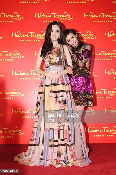 Actress Yang Mi poses with her wax figure at Beijing Madame Tussauds Wax Museum on July 5 2016 in Beijing China
