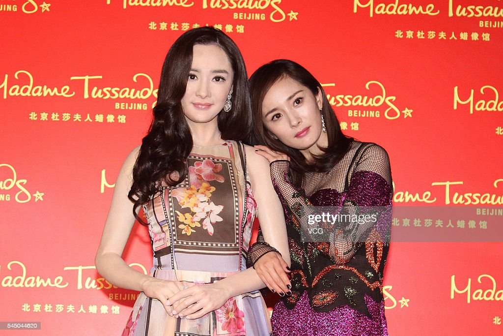 Actress Yang Mi poses with her wax figure at Beijing Madame Tussauds Wax Museum on July 5, 2016 in Beijing, China.