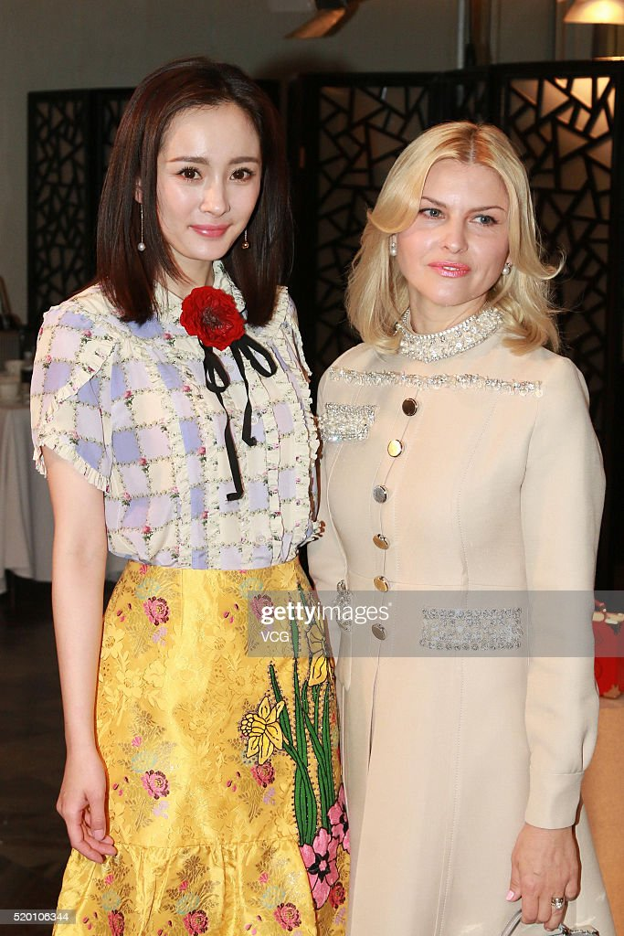 Actress Yang Mi (L) promotes luxury brand Aspinal of London on April 9, 2016 in Beijing, China.