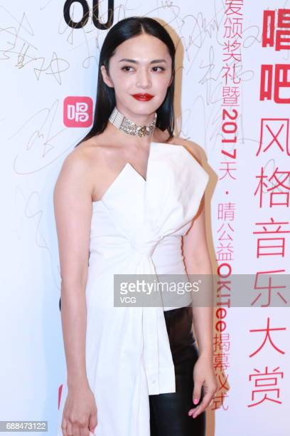 Actress Yao Chen arrives at the red carpet of the 5th anniversary award ceremony of a singing app Changba at Beijing Tiaoqiao Performing Arts Centre...