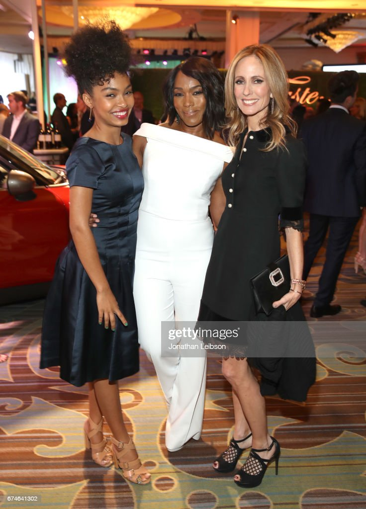 Actress Yara Shahidi, actress Angela Bassett and Vice Chair Dana Walden attend the UCLA Jonsson Cancer Center Foundation Hosts 22nd Annual 'Taste for a Cure' event honoring Yael and Scooter Braun at the Regent Beverly Wilshire Hotel on April 28, 2017 in Beverly Hills, California.