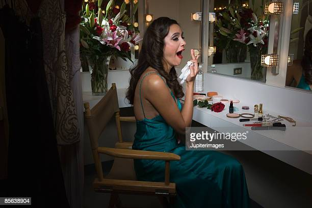 Actress yawning in dressing room