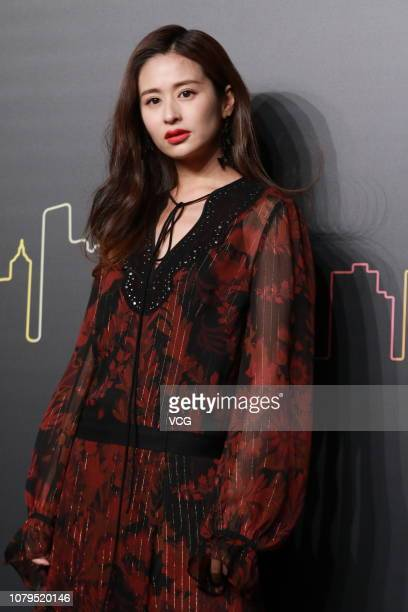 Actress Ying Er poses backstage during the Coach 2019 early autumn collection fashion show 'Coach Lights Up Shanghai' on December 8 2018 in Shanghai...