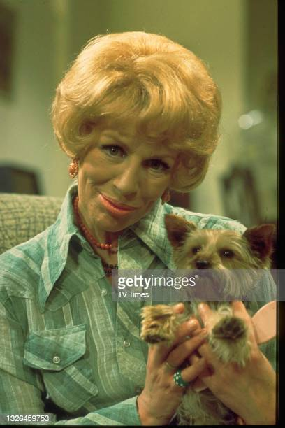 Actress Yootha Joyce in character as Mildred Roper with her dog Truffles on the set of sitcom series George And Mildred, circa 1976.