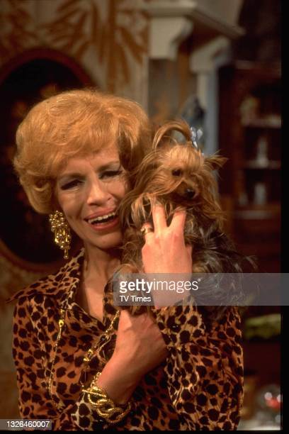 Actress Yootha Joyce in character as Mildred Roper with her dog Truffles on the set of sitcom series George And Mildred, circa 1978.