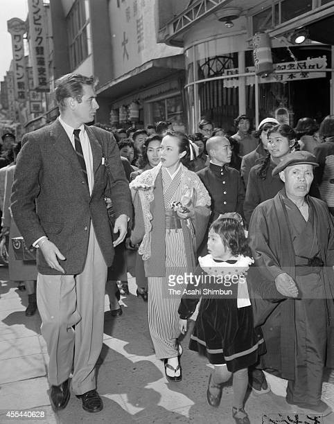 Actress Yoshiko Yamaguchi and actor Don Taylor walk in Ginza district on April 1 1953 in Tokyo Japan Born in what was once Manchuria Yamaguchi used...