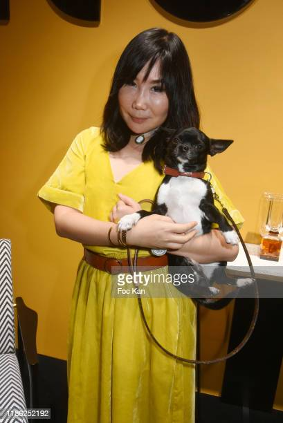 Actress Yubai Zhang and her dog Ocean attend the Red X BHV Marais Ephemere Boutique Launch Party on November 07 2019 in Paris France