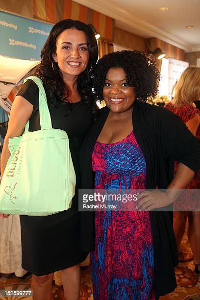 Actress Yvette Nicole Brown and Jenni Pulos attends the HBO Luxury Lounge in honor of the 64th Primetime Emmy Awards held at Four Seasons Hotel Los...