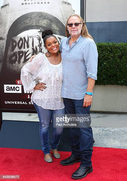 """Actress Yvette Nicole Brown and Producer Greg Nicotero attend the press event for """"The Walking Dead"""" attraction """"Don't Open, Dead Inside"""" at..."""