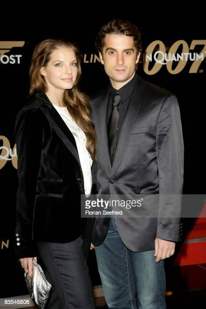 Actress Yvonne Catterfeld and boyfriend Oliver Wnuk attends the Berlin premiere of 'Quantum Of Solace' on November 03, 2008 in Berlin, Germany.